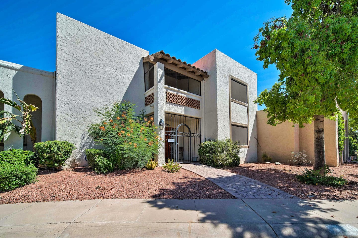 Escape to this tastefully furnished 4-bedroom, 2-bath vacation rental in Phoenix
