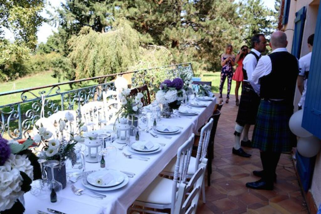 Terrace set for wedding lunch