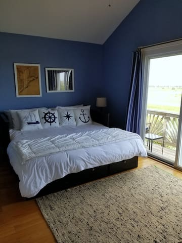 Second king bedroom with private balcony.