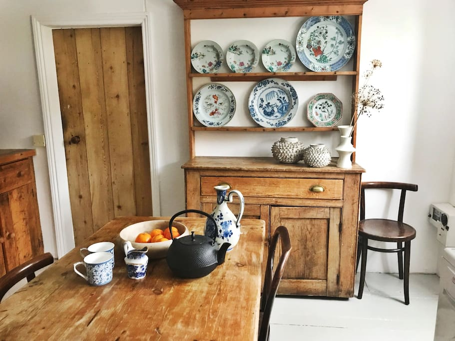 Kitchen with farmhouse table and dressers.