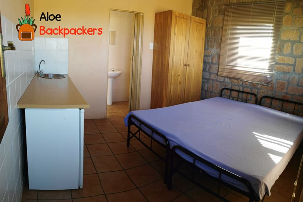 One of the rooms with 2single beds, kitchenette and bathroom
