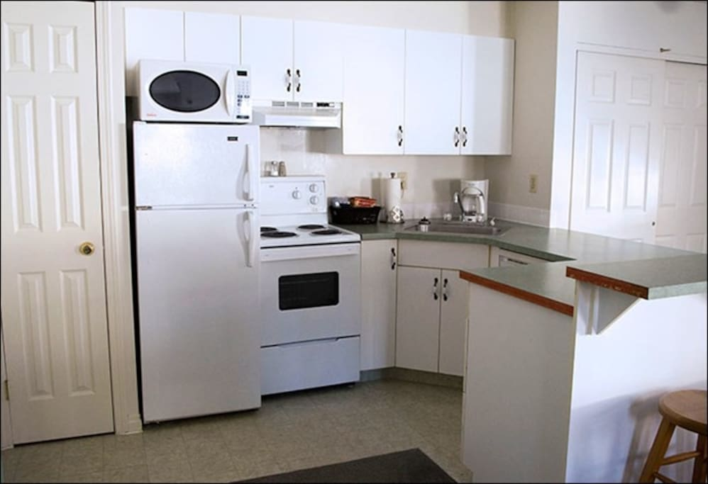 The kitchen comes equipped with everything you need to cook and dine in privacy