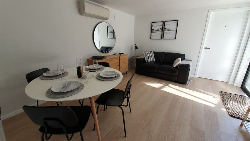 Living/dining area. TV with access to freeview, on demand & Netflix