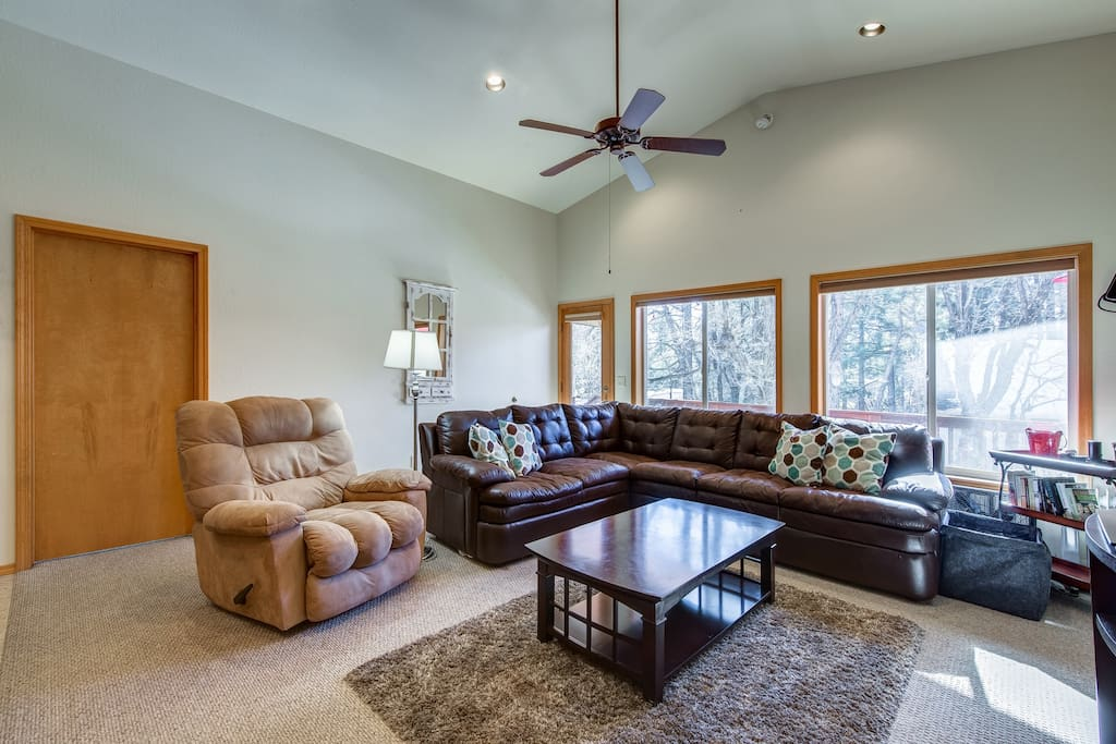 Plush furniture seats 8+ overlooking the pine trees and nature walks
