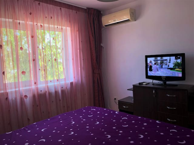 The main bedroom with 180/200 bed, TV and AC system.