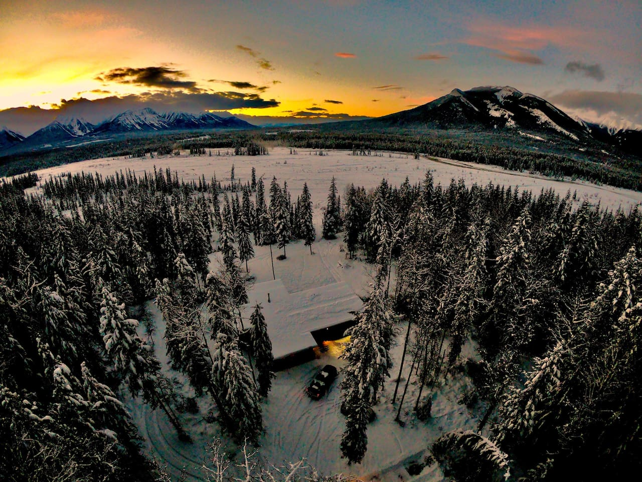 Drone shot of the house with the frozen river for miles and amazing views