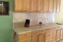 plenty of kitchen  space and full ammenities  for cooking  at home
