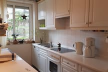 The kitchen is a common area where you can find a coffee machine, a kettle, cutlery as well as dishes for breakfast.