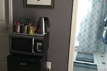 Mini fridge to keep drinks cold and a microwave and kettle to heat things up.
