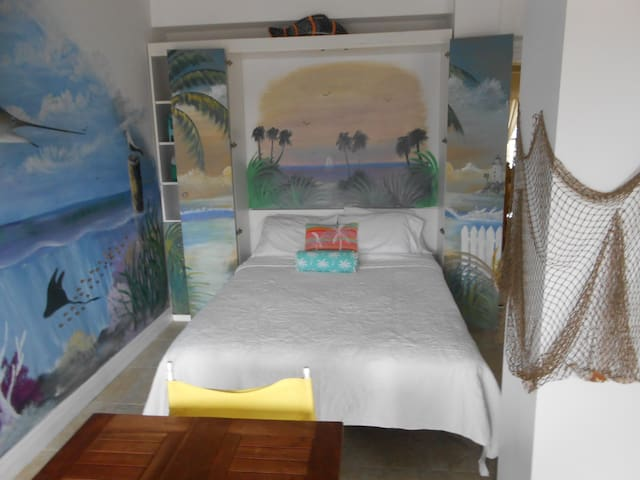 Fold-away queen Murphy Bed in Party Room with access to patio and boat dock