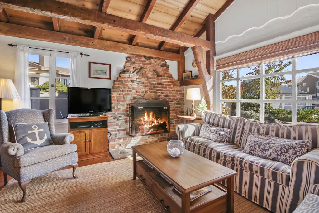 Living area for 6 with flat screen TV, complimentary Wi-Fi, and wood-burning fireplace.