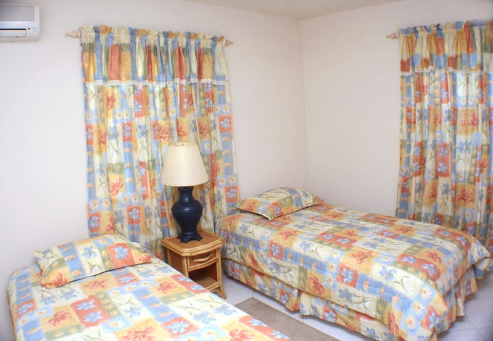 Bedroom with twin beds.  May be connected to each other.