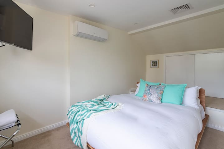 On the top floor is the second queen-sized bedroom, which benefits from a smart TV and air-conditioning.
