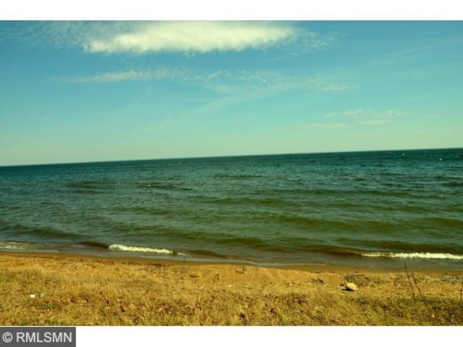 Welcome to Breezy Shore Getaway! Enjoy 100 feet of sandy lake shore with a dock.