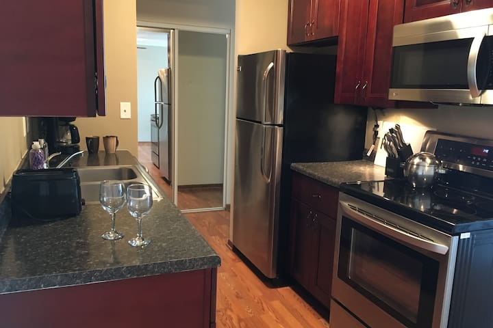 Fully equipped kitchen features stainless steel appliances.