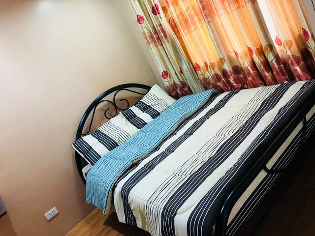 Master Bedroom with ensuite bathroom (hot/cold shower) and Queen Size bed