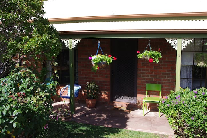 This is the entrance to the accommodation. Bendigo is said to have over 300 days of sunshine and this verandah is a great place to sit and enjoy them. It also lets light into the lounge dining room making it a lovely area to sit and relax.