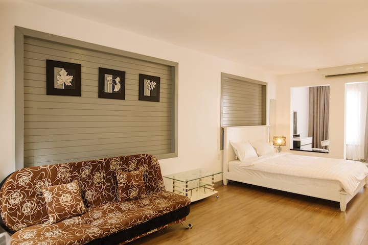 Master Bedroom #1: King size bed, attached full bathroom with spacious bathrooms with bathtub and shower, private a big wardrobe, high quality air-con, fan, HD cable TV, Sofa, optical Wifi, hot water, iron, hair dryer.