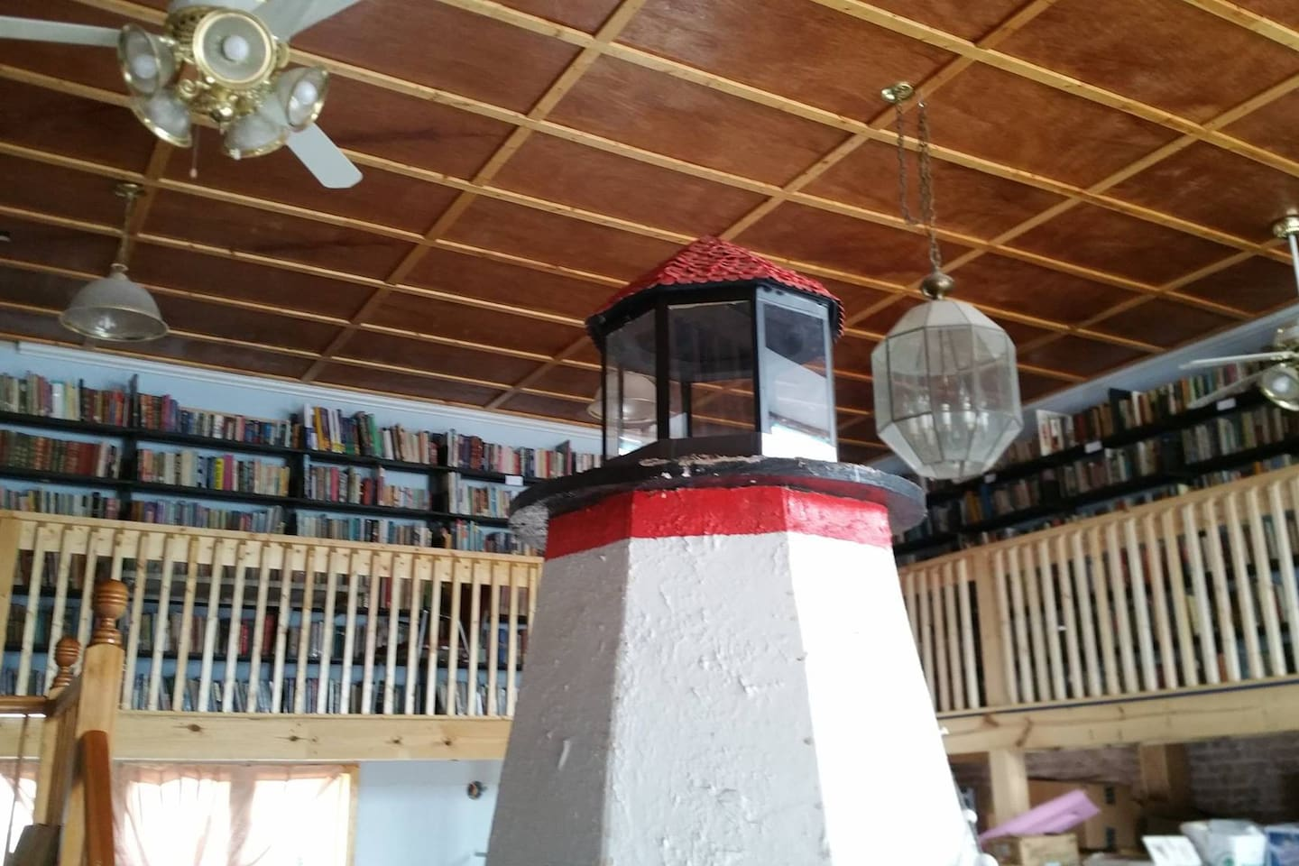 Upstairs there is a wrap-around library section. Kids love the spiral staircase leading up to the book area.
