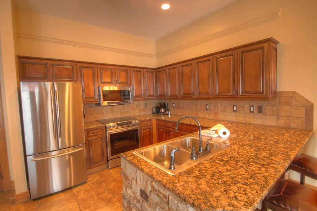 Kitchen - recently remodeled with granite counter tops and stainless steel appliances. Perfect for every level of cook.