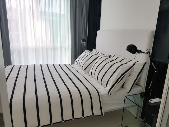 Bed room with full height windows