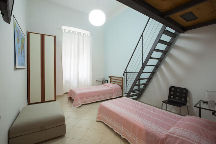 The second bedroom, with the stairway to the loft