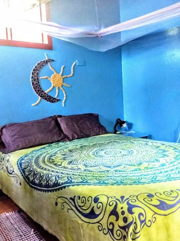 Double bed with quality sheets and towels provided. Mosquito net over the bed for optional use. Ceiling fan.