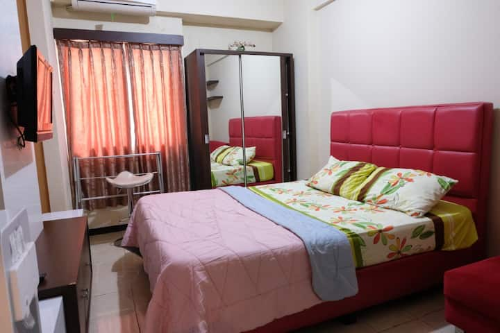 Studio Room at The Suites Metro Apartment By Zaky