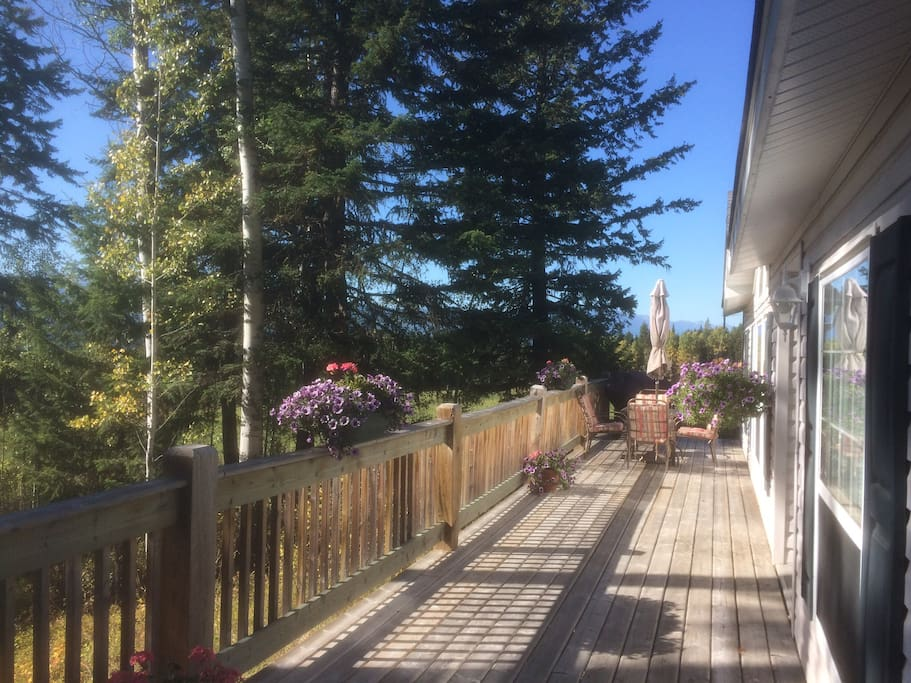 Spacious front deck with plenty of room for bbq, relaxing and viewing the 180 beauty