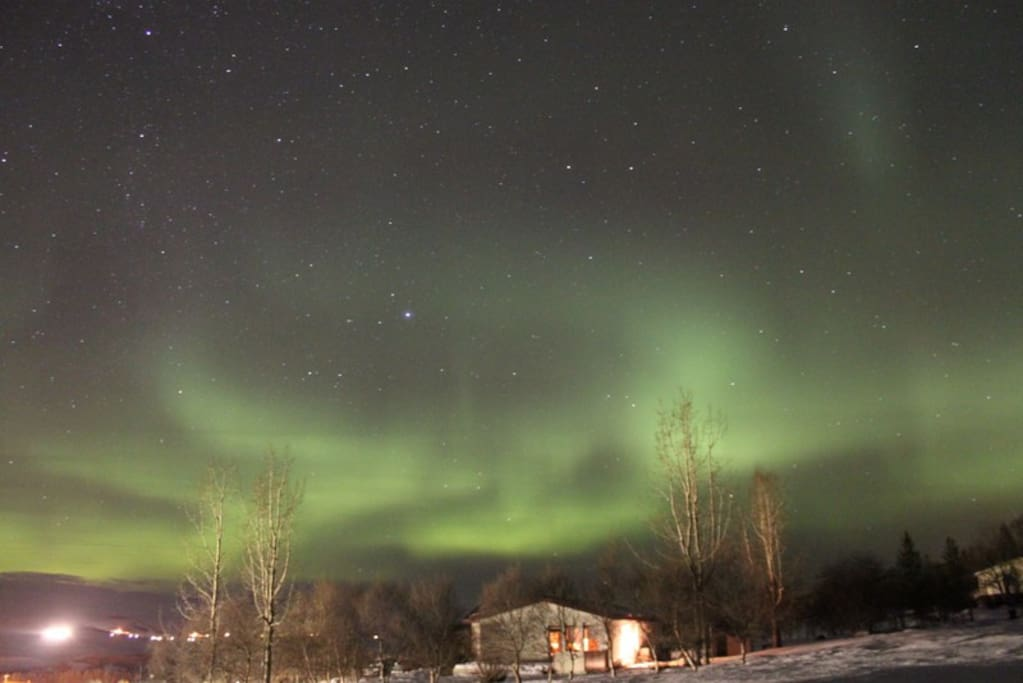 Northern Lights over Laugar Guesthouse.