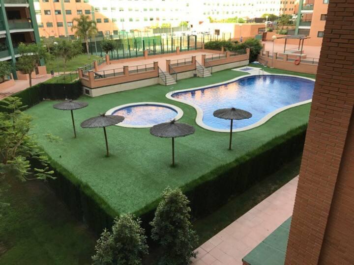 Apartamento dos habitac./terraza/ piscina/parking