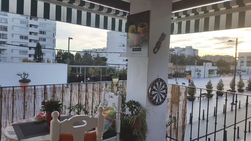 Terrace with sun all day and infront of a spacious Plaza Pueblo Sol.