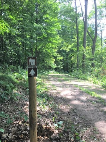 These signs are along the 1/2 mile trail leading you to the camper cabin