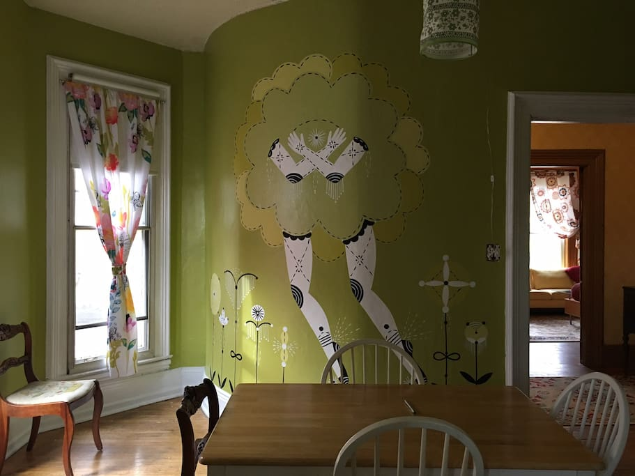 Dining room with large by famous artist, Bunnie Reiss mural