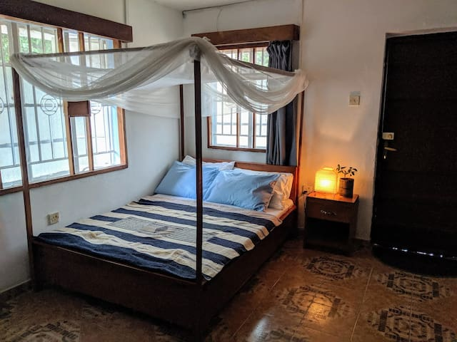 Comfortable double bed with mosquito net (all windows also have mesh to protect you!)