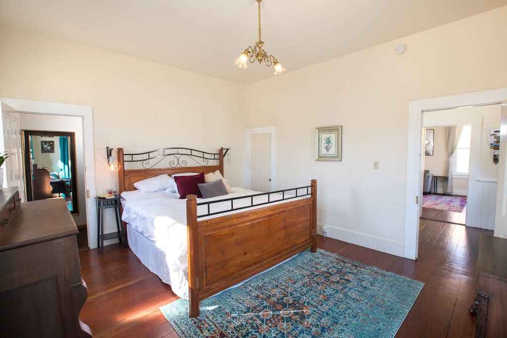 Comfy master suite with a private bathroom, huge king-size bed with memory foam, and cozy reading nook.