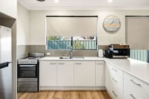Full size kitchen with fridge, stove, oven, capsule coffee machine and a large array of kitchen utensils available for you to create a culinary delight