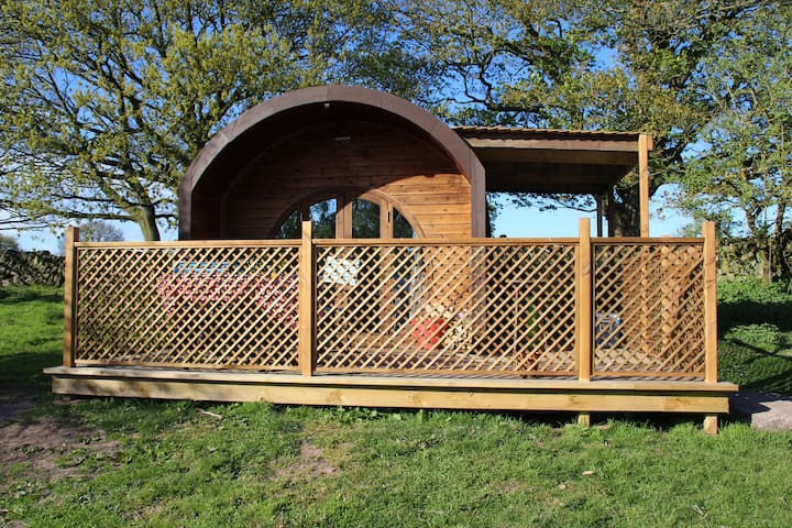 Secluded Pod with outside kitchen and dining area.