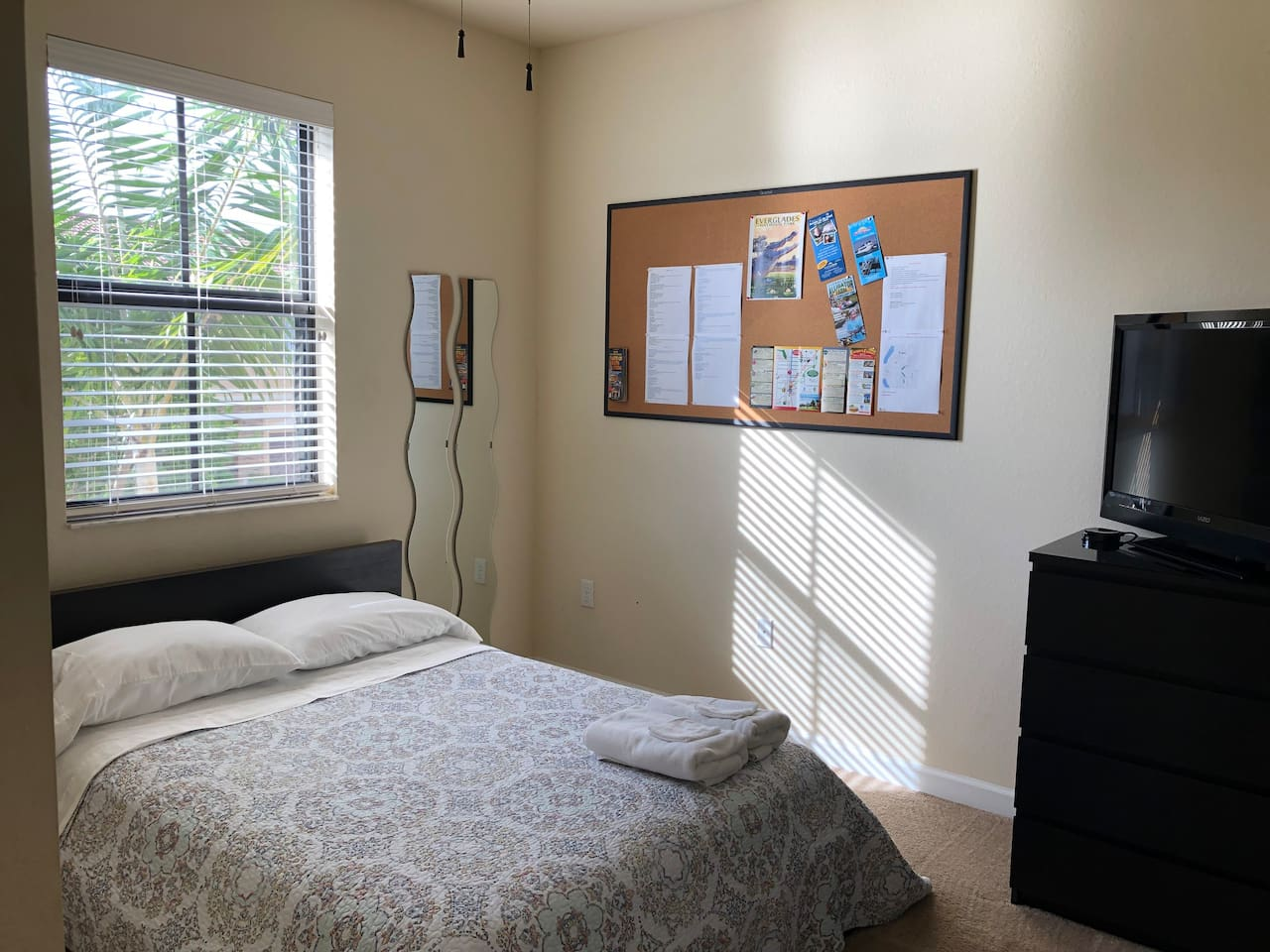 Bedroom with full bed on second floor. View to the exterior