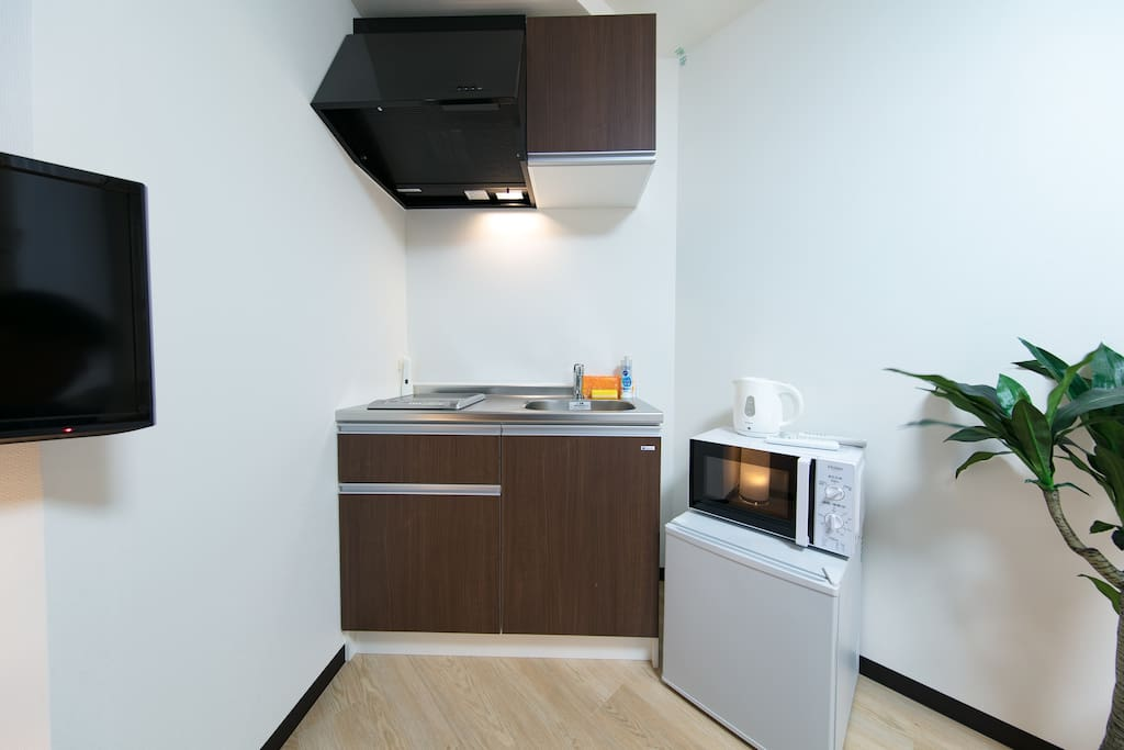 Kitchen and laundry machine! Microwave, refrigerator... its like a home sweet home isn't it? Cook for yourself using local ingredients! Or even simply warm anything you bought from stores!