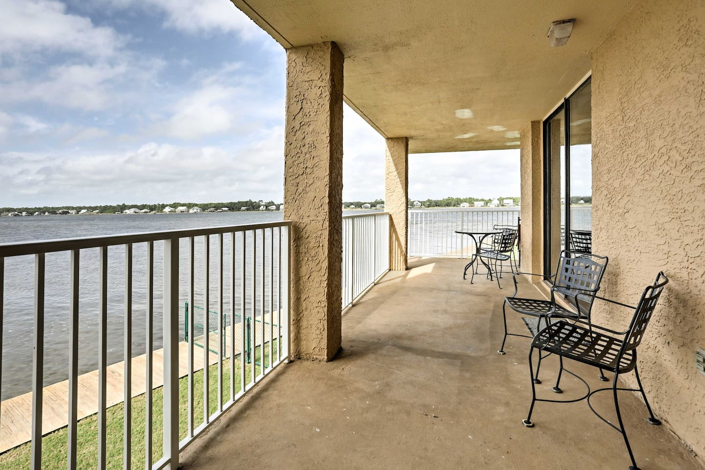Admire beautiful sunsets over Little Lagoon from the wraparound balcony of this vacation rental condo in Gulf Shores!