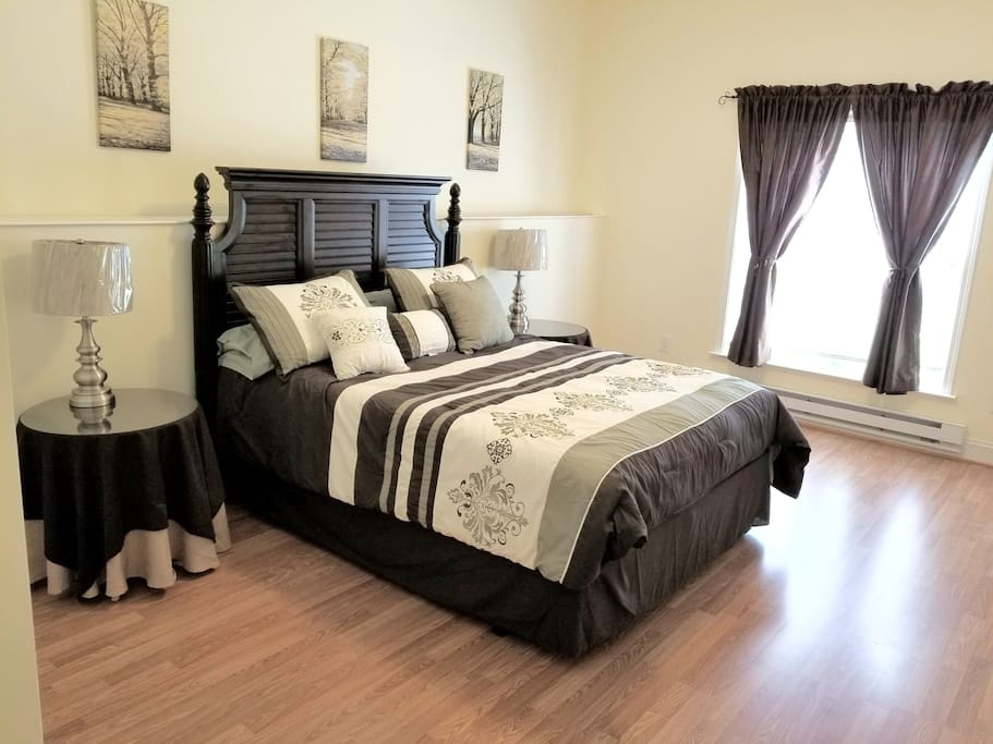 Large bedroom with queen size bed.