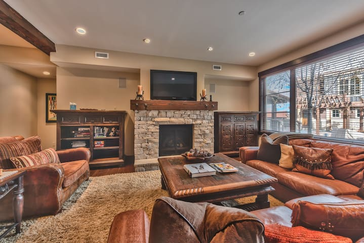 Living Room with Comfortable Leather Furnishings, TV and a Gas Fireplace