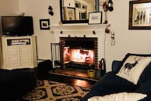 Get cozy by the fire.