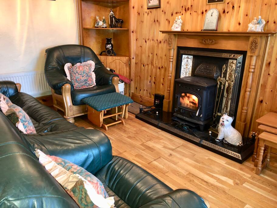 Sitting room is warm and cozy with a stove to heat it