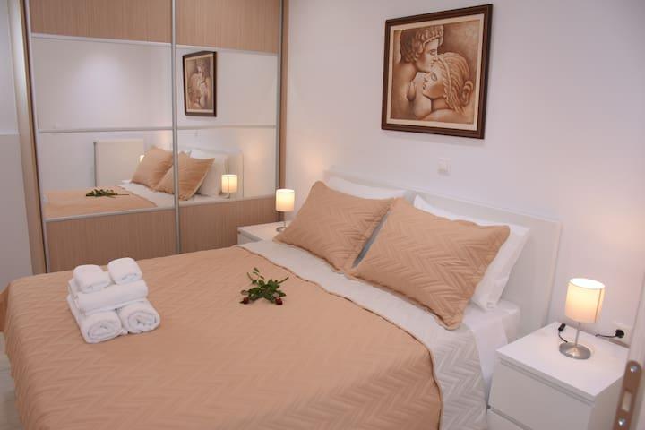 Master bedroom -a/c -flat tv -mirror