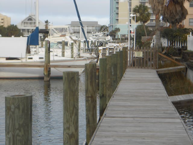 Dock path to Peg Leg Pete's Oyster Bar and Tom Thumb