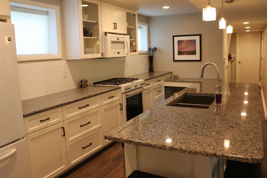 Custom cabinets and a subway tile backsplash complement the granite countertops.