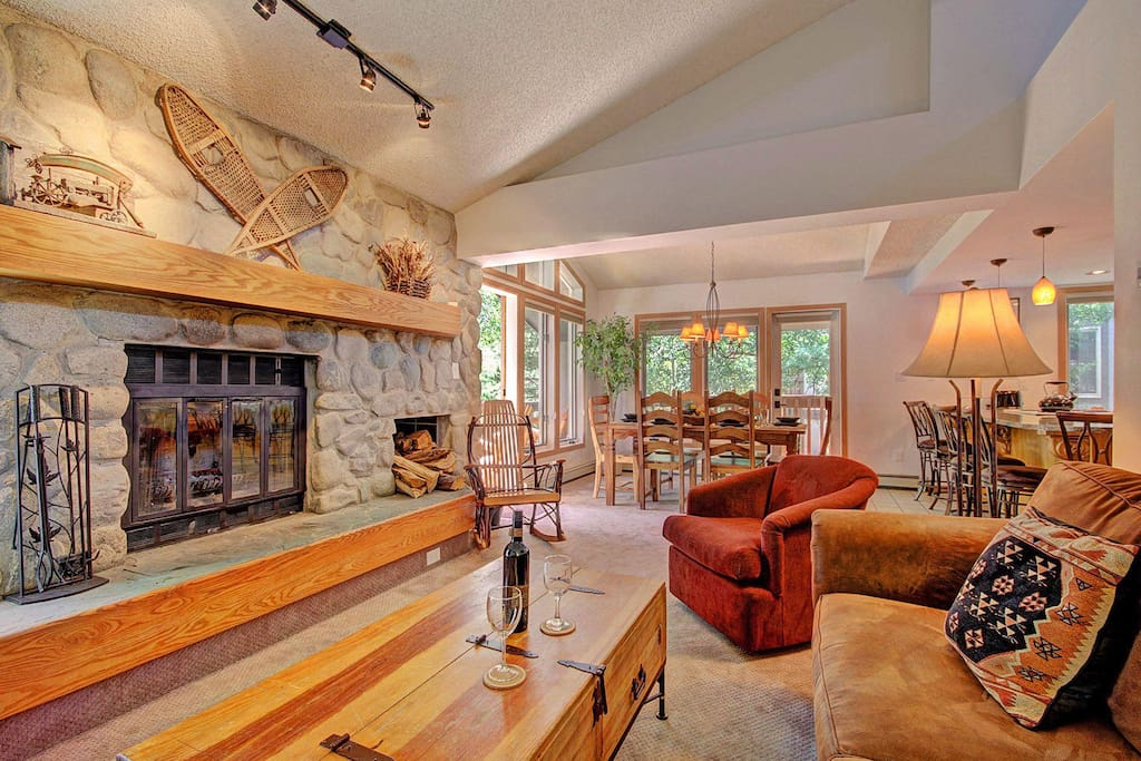 Living room with wood burning fireplace - Living area features wood burning fireplace.