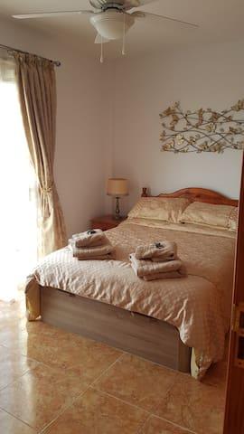Double bedroom with viewing balcony overlooking La Gomera and La Palma.